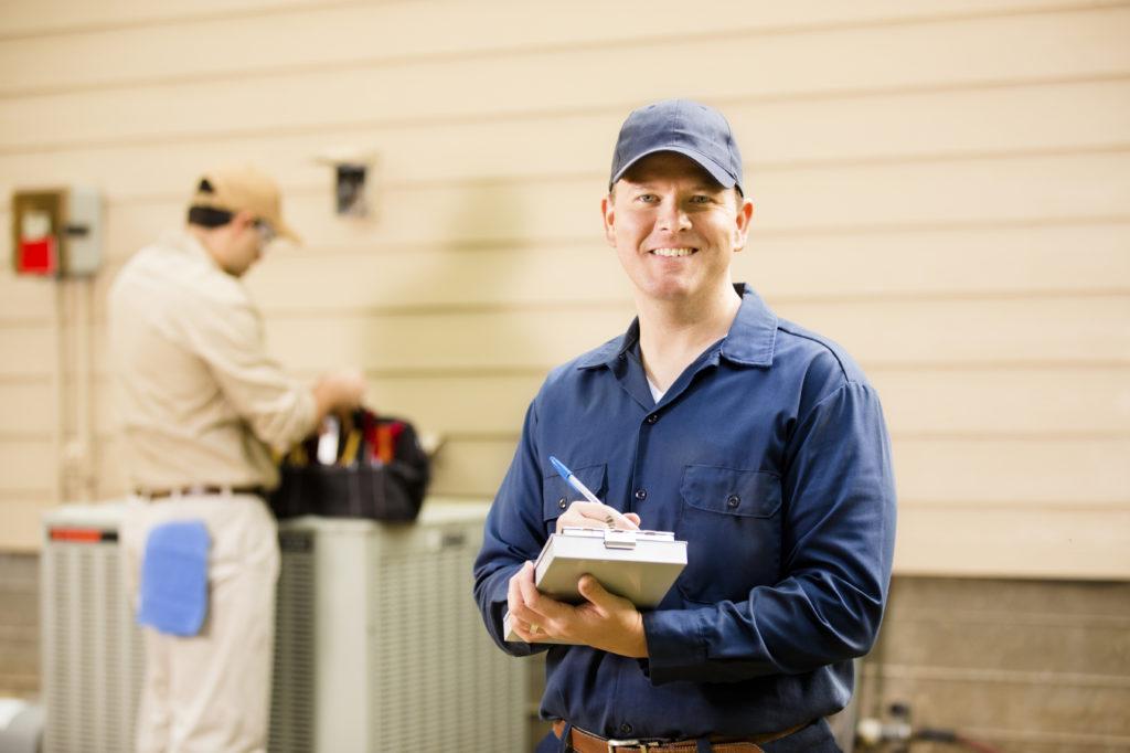 Air conditioner repair technician