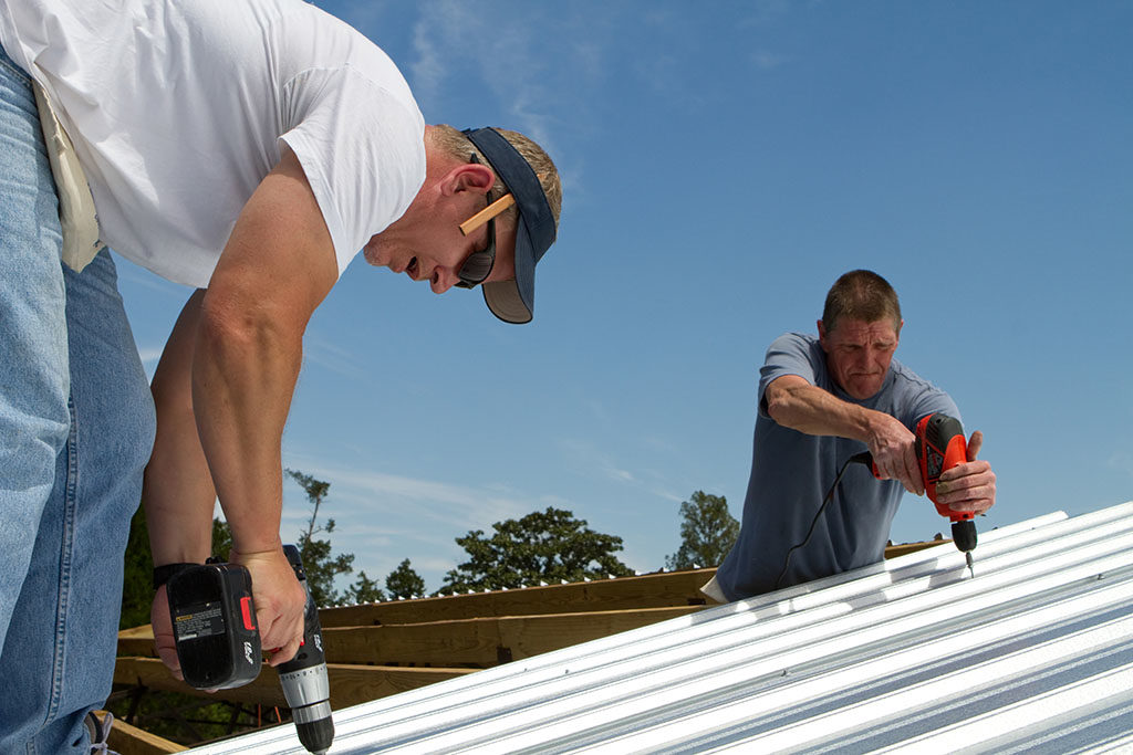 Help Your Air Conditioner Out This Summer By Improving Your Roof